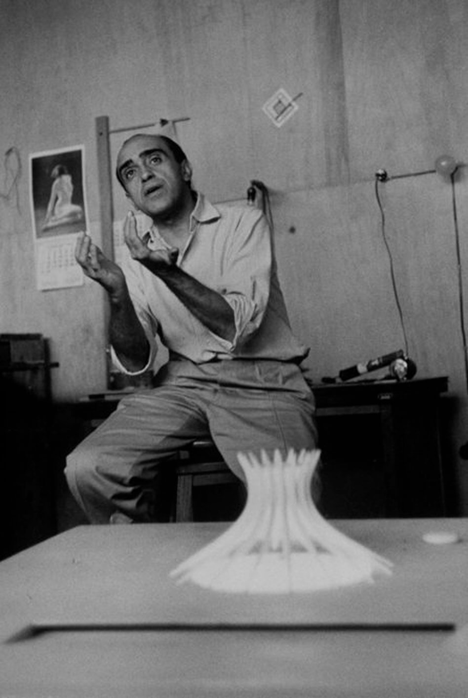 Architect Oscar Niemeyer in the shack he used for office while building Brazil's new capitol.  (Photo by Frank Scherschel//Time Life Pictures/Getty Images)
